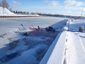 SAGINAW, Mich. - The 65-foot tug Ann Marie sank and became encased in ice overnight Dec. 12, 2010, in Saginaw Bay, Mich. Coast Guard and local fire department responders are working with representatives from the company that owns the tug to develop salvage plans. (U.S. Coast Guard photo)